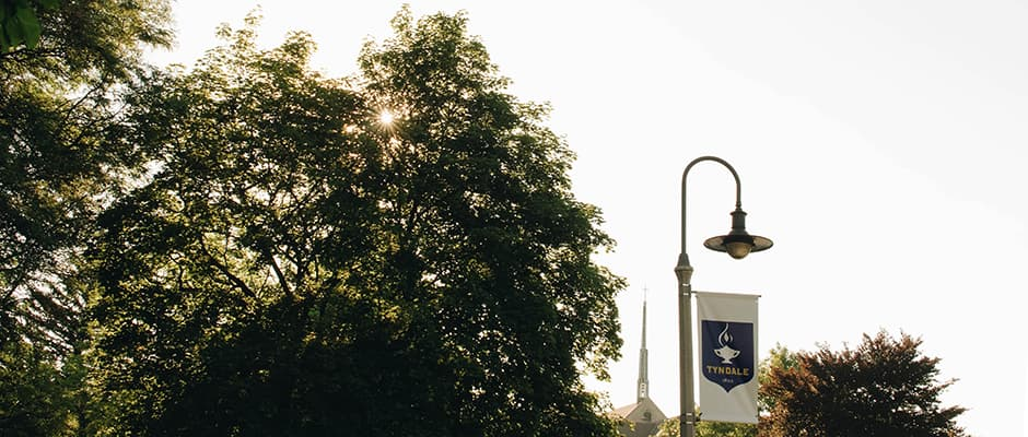 Tyndale campus with lampost Tyndale flag