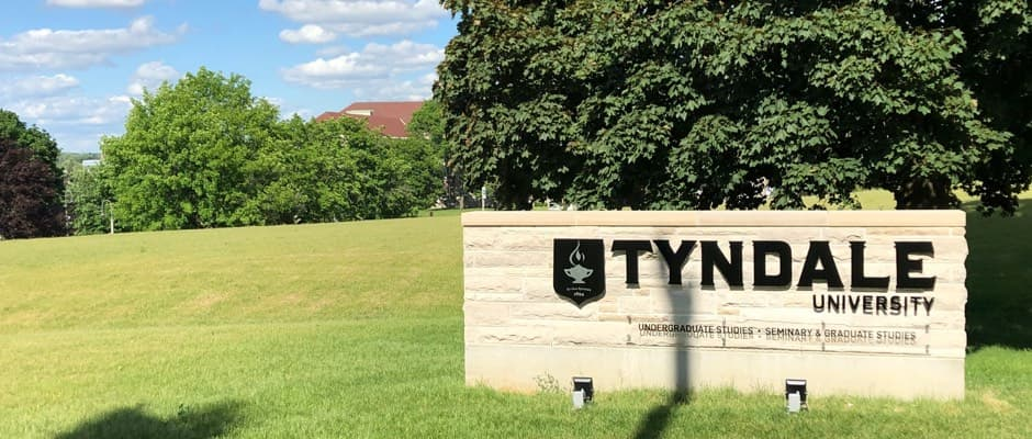 Tyndale University sign at the front of campus