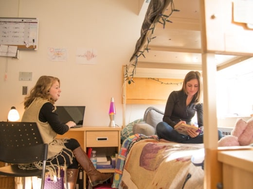 two female students hanging out in a Tyndale resience room