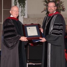 Dr. Bob Morris recieving Doctor of Divinity Honoris Causa from Dr. Gary Nelson in 2011
