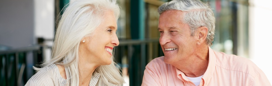 an older couple smiling at each other