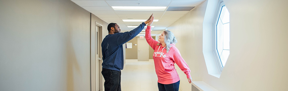 Two students high five