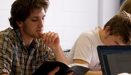 Two Tyndale students studying and reading the Bible