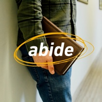 Someone with a bible and the word abide.