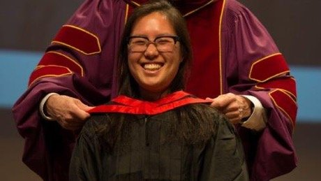 Female student at graduation being robed