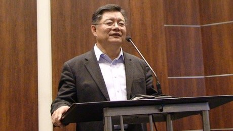 Rev. Hyeon Soo Lim preaching while standing at a podium
