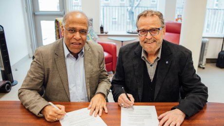 Rev. Dr. Rupen Das and President Gary Nelson signing agreement