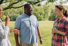Three students conversing outdoors