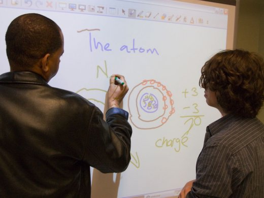 teacher canidate teaching science to a student