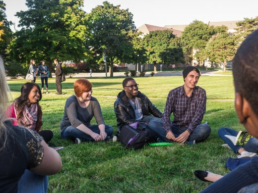 Students Sitting in a Circle Outside