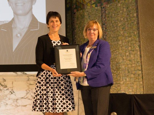 Darlene McLean-Albrecht recieving Distinguished Alumni National Impact Award in Tyndale's Chapel