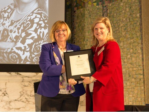 Stacey Campbell recieving the Distinguished Alumni Horizon Award in Tyndale's Chapel