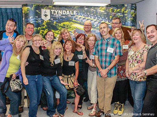 An enthusiastic group of Tyndale alumni making silly faces