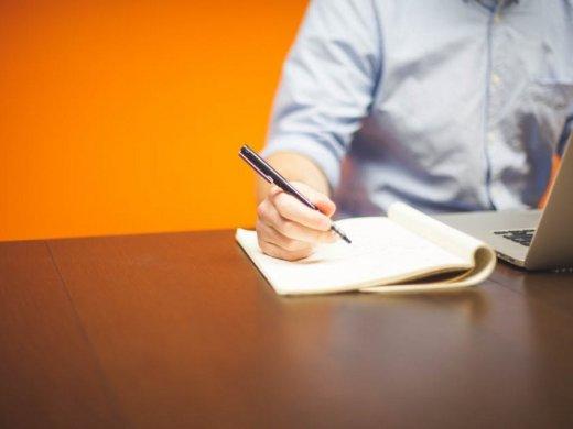 Man taking notes at a desk