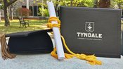 graduation cap with scroll and tyndale diploma