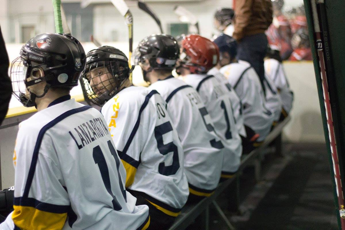 Row of hockey players sitting on bench