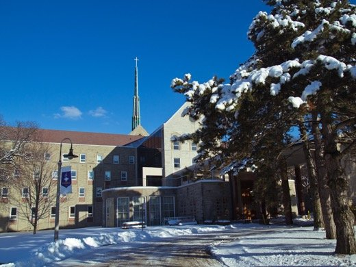 Main entrance view of Tyndale campus during winter with snow
