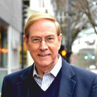Tight Headshot of Gary Chapman - glasses and a blue suit