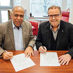 Rev. Dr. Rupen Das and President Gary Nelson signing agreement for Tyndale Academic Press