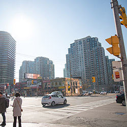 Toronto Cityscape showing a few highrise buildings, in front of which is a busy intersection